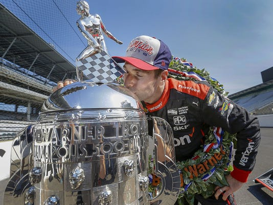 Winner of the102nd running of the Indianapolis 500 Will Power kisses the Borg-Warner Trophy at Indianapolis Motor Speedway on Monday, May 28, 2018.