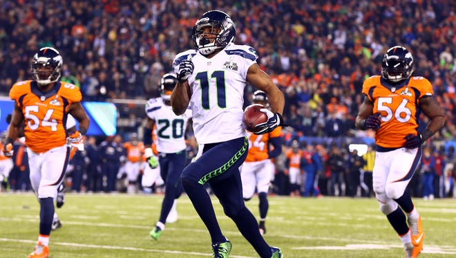 Seattle's Percy Harvin takes the opening kickoff of the second half back 87 yards for a TD and 29-0 lead.