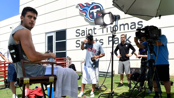 Titans quarterback Marcus Mariota waits to take part in an interview with ESPN after practice Sunday at Saint Thomas Sports Park
