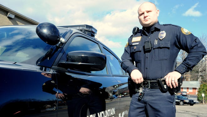 Black Mountain police officer Grant Caison is among the officers testing body-worn cameras for the department.