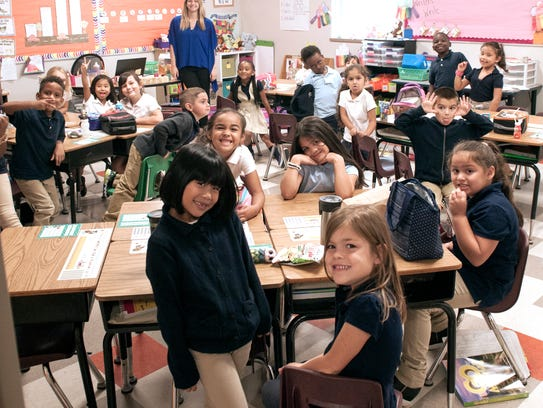 First-grade students gather inside their classroom