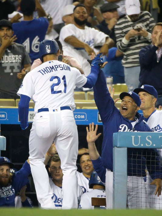 Los Angeles Dodgers' Trayce Thompson (21), left, celebrates his three-run home run with manager Dave Roberts during the third inning of a baseball game against the Milwaukee Brewers, Thursday, June 16, 2016, in Los Angeles. (AP Photo/Jae C. Hong)