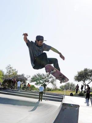 Abel Alvarez, 28, of Salinas grabs some serious air during a skateboard trick at Natividad Creek Skate Park.