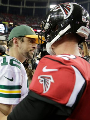 Packers QB Aaron Rodgers, left, and Falcons QB Matt Ryan after their Oct. 30 meeting, won by Atlanta, 33-32.