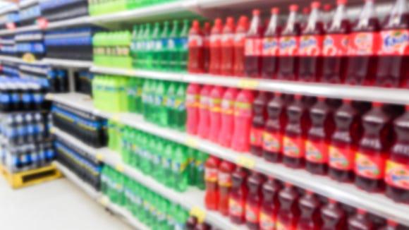 Drink bottles on display on shelves in a supermarket