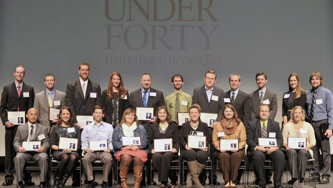 Twenty Under Forty honorees, front row from left, Methuselah Thao, Kelly Schultz, Kevin Kraft, Melissa Dotter, Sherri Selting, Marie Kieffer, Leslie Brown, Ebert Nitzke and Hayley Cramer. Back row from left, Henry Yach III, Lance Trollop, Brian Hoover, Kimberly Larsen, Michael Clark, Timothy Buchholz, Kelly Goetsch, Leif Christianson, Bob Lamovec, Kari Rasmussen and Nickolas Sandquist. daily herald media file photo