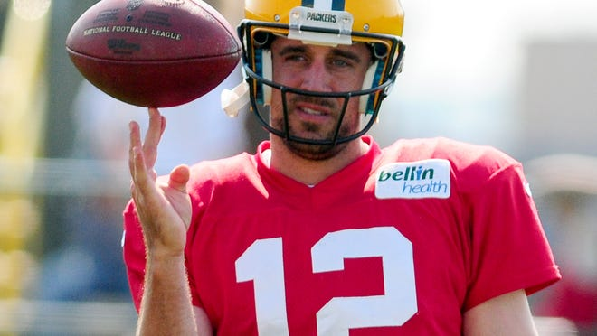 Is a team's highest-paid player also its leader? In the case of Green Bay Packers quarterback Aaron Rodgers, yes.