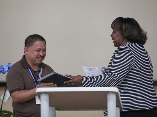 """Bobby Duke Middle School teacher Edwin DeToya receives the Riverside County """"Teacher of the Year"""" recognition from County Superintendent Linda White, in Coachella, May 26, 2017."""