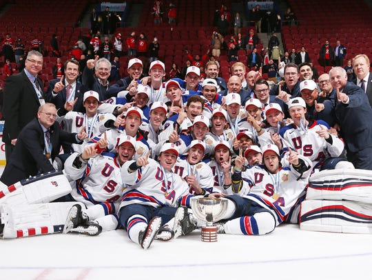 USA players and staff celebrate after a 5-4 shoot-out