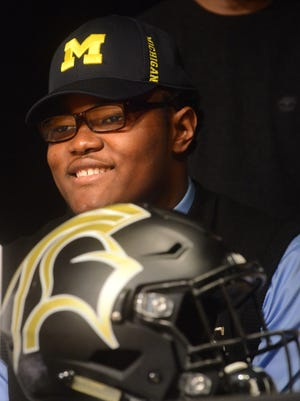 Rashan Gary, a defensive end from Paramus Catholic, smiles at the signing of his letter of intent to attend Michigan and play football, Wednesday, Feb. 3, 2016, in Paramus, N.J.