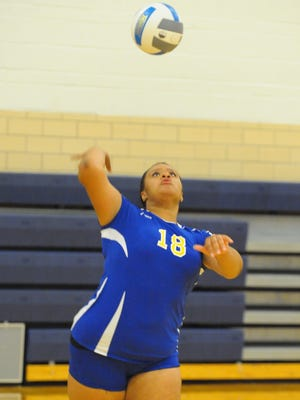 Redford Union senior Sasha Sartin delivers a serve during Tuesday night's victory over Redford Thurston.