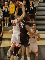 Oskaloosa's Cole Henry, 40, and Grinnell's Cade McKnight, 40, fight for the basketball during Grinnell's 71-53 victory.