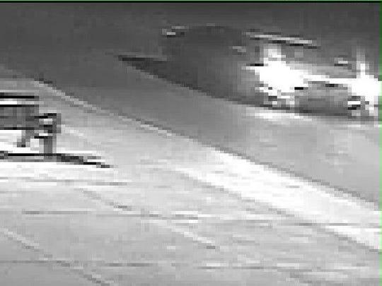 A still taken from surveillance video shows a light-colored