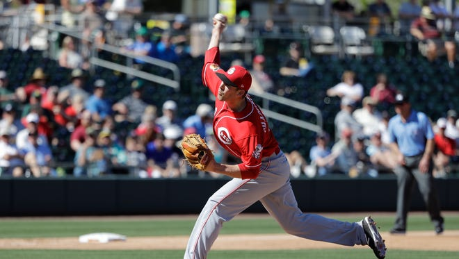 Cincinnati Reds' Kevin Shackelford throws during a spring training baseball game against the Oakland Athletics, Thursday, March 9, 2017, in Mesa, Ariz. (AP Photo/Darron Cummings)