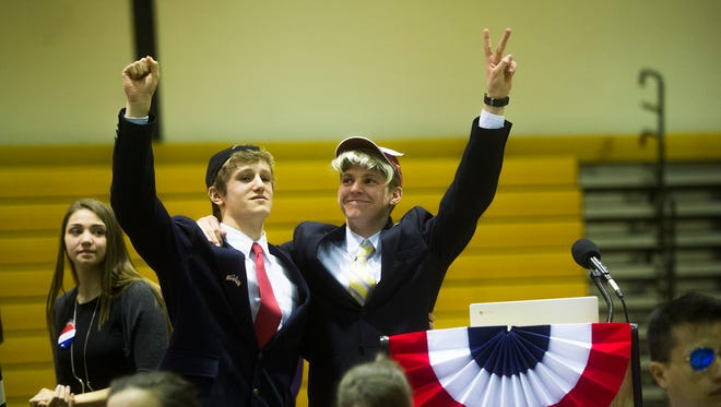 Alexander Trummer as Sen. Marco Rubio, left, and Will Greene as Donald Trump, declare victory at the end of the mock political convention at Delone Catholic High School on March 23, 2016.