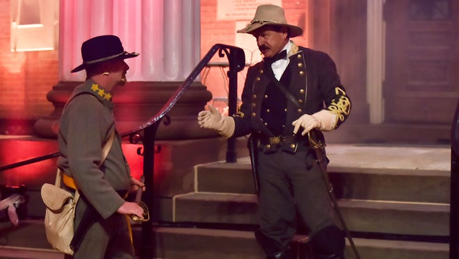 """Reenactors depict a conversation like what would have taken place during the Burning of Chambersburg, at """"1864:The Burning"""" reenactment light show on Saturday, July 16, 2016."""