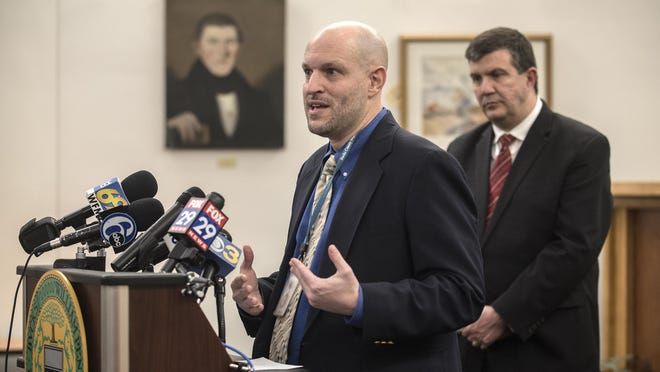 File - Dr. David Damsker, director of the Bucks County Health Department speaks during a briefing on the Coronavirus at teh Bucks County Administration Buliding in Doylestown Borough on Wednesday, March 11, 2020.