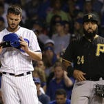 Chicago Cubs' Kris Bryant (left) checks his helmet after hitting a single as Pittsburgh Pirates first baseman Pedro Alvarez looks on. Neither team should be in the NL Wild-Card game, but they are.