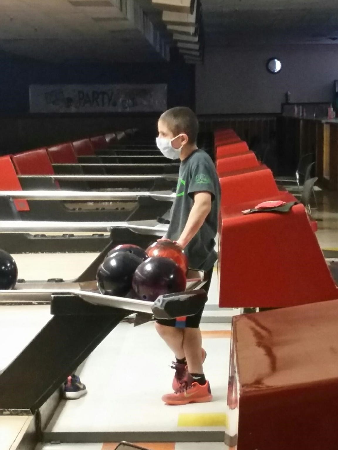 Bowling alone during off-hours, wearing a mask to prevent against infection, Cameron Hurwitz never gave up on dream of normal life and returning to Brighton High School team.