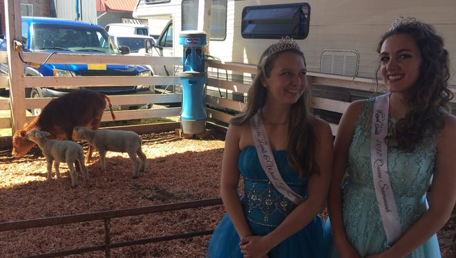 Raven Willard, left, and Savannah Sharp, respectively the 2016 and 2017 queens of  Linn County Lamb & Wool Fair in Scio.