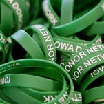 Bracelets promoting the Iowa Donor Network were given out at a Roosevelt High School swim meet on Dec. 31, 2013. The Iowa Donor Network plans to relocate its office from Johnston to Altoona.