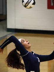 Whitnall's Samantha Benzinger serves in action from