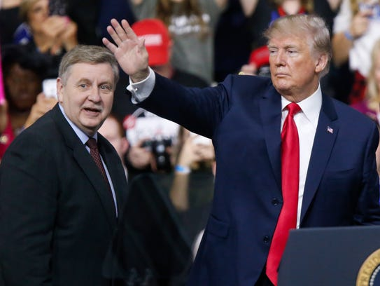 President Donald Trump, right, acknowledges the crowd during a campaign rally with Republican Rick Saccone, Saturday, March 10, 2018, in Moon Township, Pa. Saccone was running in a special election for Congress. He lost.