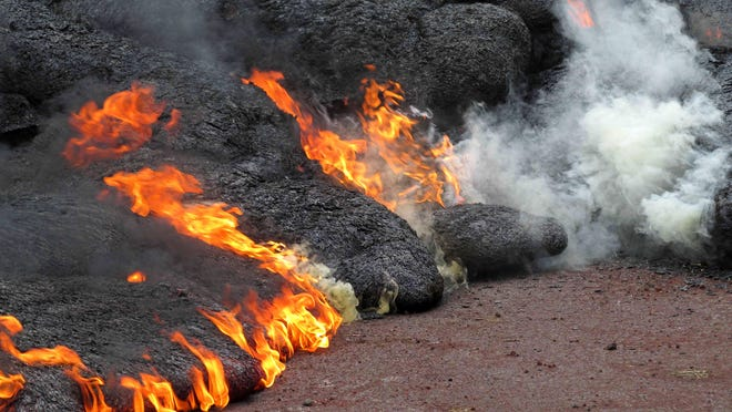 This Nov. 9, 2014 photo provided by the U.S. Geological Survey shows the lava flow from the Kilauea Volcano that began on June 27 as it burns near the town of Pahoa on the Big Island of Hawaii.