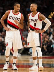 Portland Trail Blazers guards C.J. McCollum (left) and Damian Lillard are hoping to entice Carmelo Anthony to join their team.