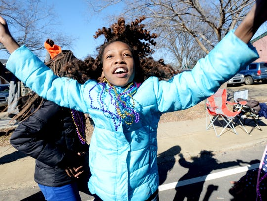 Jon'Nya Miller tries her best to catch beads during