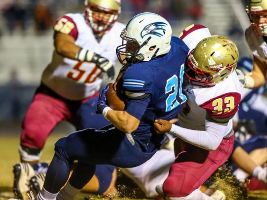 Hardin Valley's Colton Burns is tackled by Riverdale's Marques Locke during a 6A playoff game Friday.