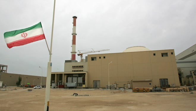 Iranian flag outside the a nuclear reactor in Iran in 2007.