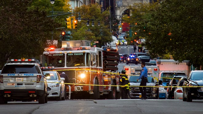 Firefighters work in the scene after a motorist drove onto a busy bicycle path near the World Trade Center memorial and struck several people Tuesday, Oct. 31, 2017, in New York.