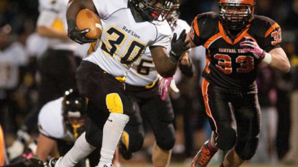 Red Lion's Kenny Holloway (30) runs last season against Central York in a YAIAA Division I football matchup. (File photo)