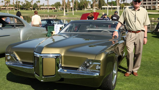 2/23/14 10:09:36 AM -- Cathedral City, CA, U.S.A  -- Customized 1969 Pontiac Grand Prix, Dave Crook of San Dimas, Calif. at the Desert Classic Concours d'Elegance in Cathedral City, CA  --    Photo by Dan MacMedan, USA TODAY contract photographer  ORG XMIT:  DM 130708 Show us Your Car 2/23/2014 [Via MerlinFTP Drop]