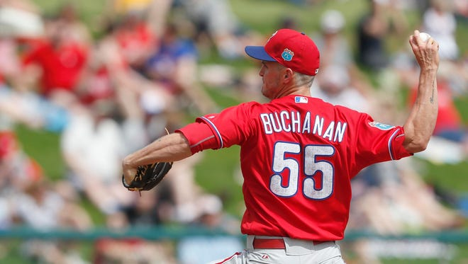 Phillies starting pitcher David Buchanan pitches Friday against the Atlanta Braves during the first inning at Champion Stadium. Buchanan and Alec Asher were optioned to Triple-A Lehigh Valley on Tuesday.