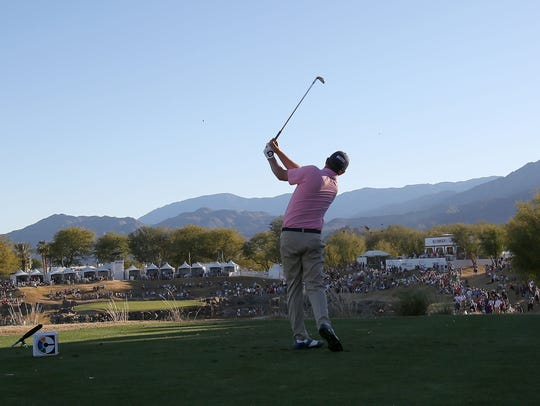 Jason Dufner tees off on the 17th hole during the final