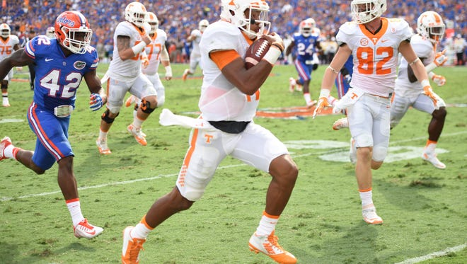 Tennessee quarterback Joshua Dobbs (11) beats Florida defensive back Keanu Neal (42) down the sideline for a touchdown in 2015.
