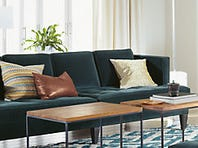 CB2's Avec sofa in peacock blue adds a fun pop of color to a room. It's $1,199 at cb2.com.