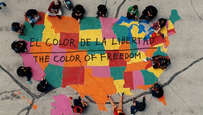 "Students at Alexander Mitchell school created a song and video with Mikal Floyd-Pruitt. The song is called ""El Color de la Libertad."""
