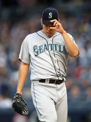 Seattle Mariners starting pitcher Yusei Kikuchi leaves the mound in the third inning of a baseball game against the New York Yankees, Wednesday, May 8, 2019, in New York. (AP Photo/Kathy Willens)