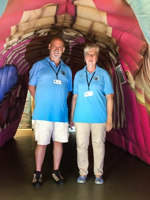 Gerry and Karen Beetham, docents at the Cape Cod Museum of Natural History in Brewster, walk through the Inflatable Gray Whale display, which will be open Thursday for the first time this summer.