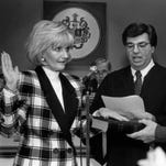 In this Nov. 23, 1993, file photo, Joan Bramhall, left, is sworn in as new Morris County Freeholder by Morris County Judge, Ted Bozonelis, while John Bramhall holds the Bible.