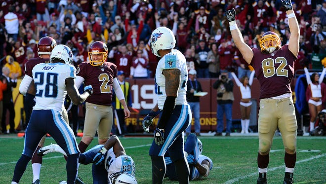 Redskins kicker Kai Forbath (2) and tight end Logan Paulsen (82) celebrate after kicking the game-winning field goal as time expired against the Titans on Sunday.