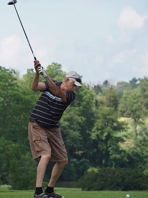 Chet Woodward of Ashland drives the ball from the 10th tee Thursday afternoon at Valley View Golf Course.