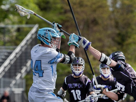 CBA's Michael Carroll takes a shot on goal during first