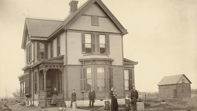 Thomas J. Anderson built a magnificent home at 200 E. 6th, shown here in 1885.