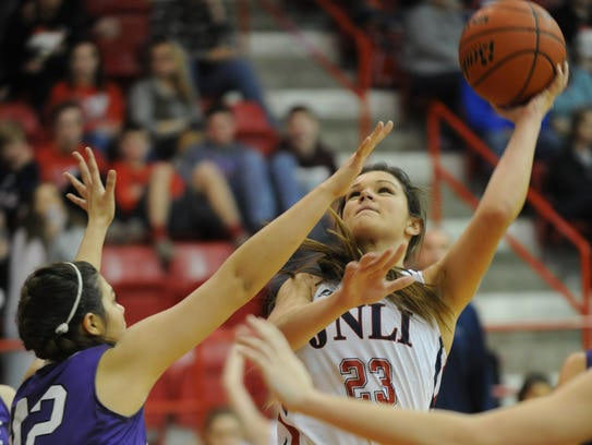 Jim Ned's Libby Tutt, right, shoots over Wylie's Jaden