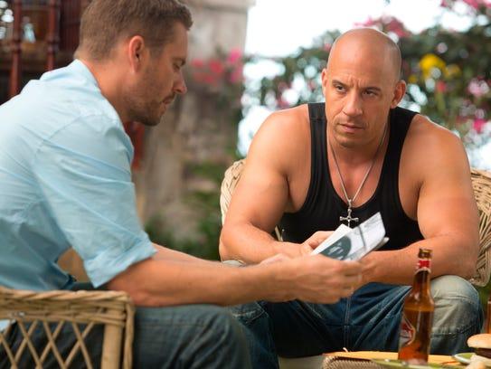 Brian (Paul Walker, left) and Dom (Vin Diesel) share