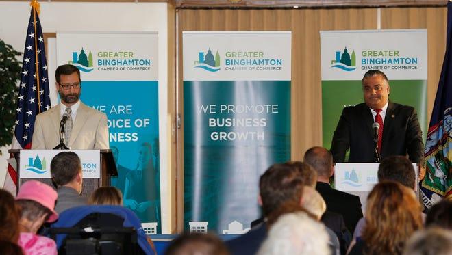 Binghamton Mayoral candidate Tarik Abdelazim and Mayor Richard David speak during Tuesday's mayoral debate hosted by the Greater Binghamton Chamber of Commerce on September 26, 2017.